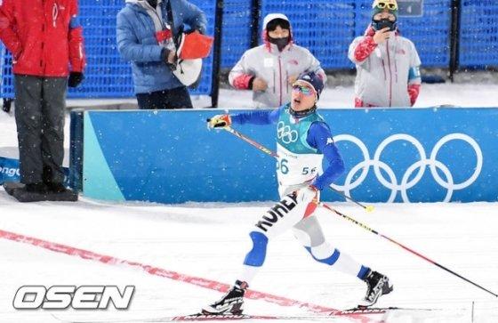 결승선을 통과하는 김마그너스.